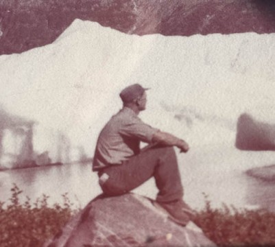 Arnold Muldoon in front of glacier.
