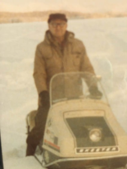 Arnold Muldoon snowmachining, possibly at Big Lake.